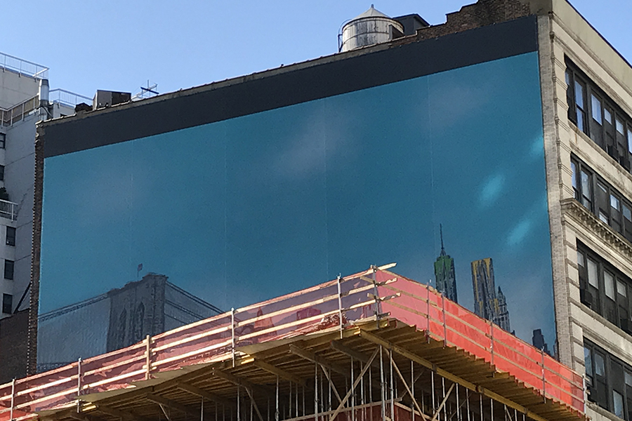 Billboard in a construction job site in Manhattan | Knowify